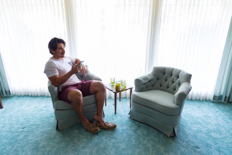 Man sitting in a retro room with martini glasses